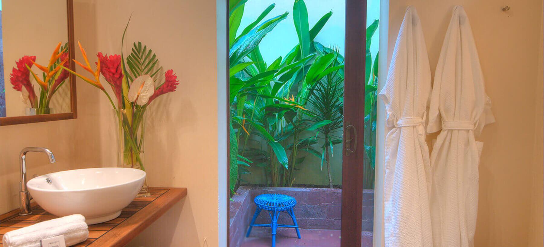 Bathroom with outdoor shower at 473 Grenada Boutique Resort