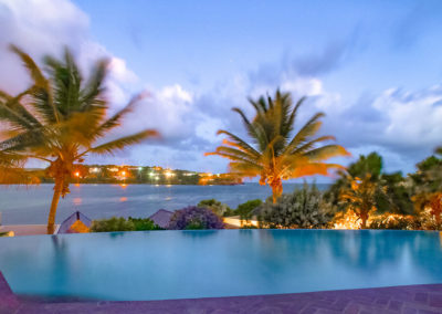 Night view of the infinity pool at 473 grenada boutique resort